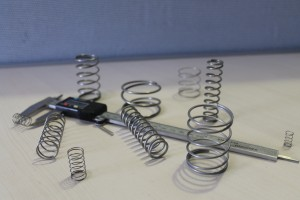 A variety of compression springs with a gauge
