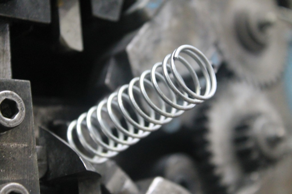 Compression Spring being wound and finished